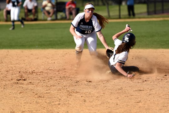 From the 2019 Bergen County Tournament: Immaculate Conception's Jaden Farhat and Ramsey's Emma Cunningham at third base.