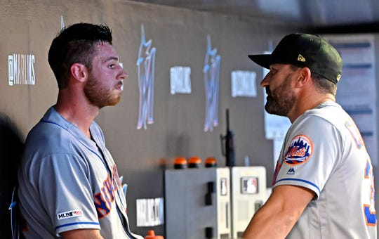 May 18, 2019; Miami, FL, USA; New York Mets starting pitching Steven Matz (left) listens to Mets manager Mickey Callaway (right) in the dugout during the fourth inning against the Miami Marlins at Marlins Park.