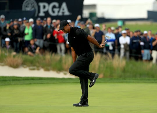 Tiger Woods of the United States reacts to a missed putt on the 17th green during the second round of the 2019 PGA Championship at the Bethpage Black course on May 17, 2019 in Farmingdale, New York.