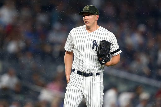 Chad Green #57 of the New York Yankees reacts in the seventh inning against the Tampa Bay Rays at Yankee Stadium on May 17, 2019 in New York City.