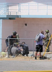 Las Cruces authorities attend to a person who was at the Budget Inn, 2255 W. Picacho Ave., when a fire broke out on Saturday, May 18, 2019.