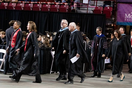 Las Cruces Public Schools Superintendent Dr. Greg Ewing, center background, makes his way into the Pan American Center with LCPS board president Ed Frank and other administration officials for Centennial High School's graduation ceremony on Friday, May 17, 2019.