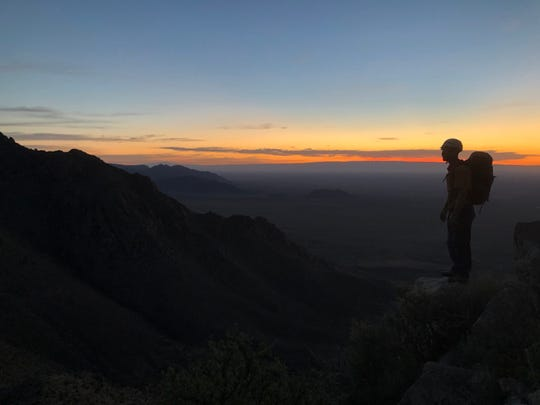 The sunrise on May 5 silhouettes Jon Tylka atop the Organ Mountains.