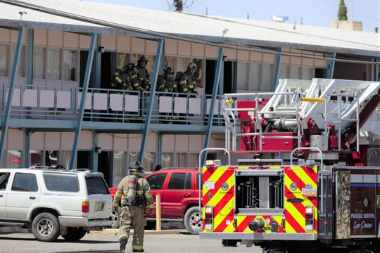 Firefighters respond Saturday, May 18, 2019 to a fire at the Budget Inn, 2255 West Picacho Ave., Las Cruces.