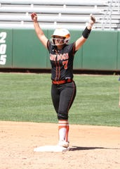 Artesia's Kamiley Marquez signals to her dugout after hitting a double during Saturday's championship game against Silver.