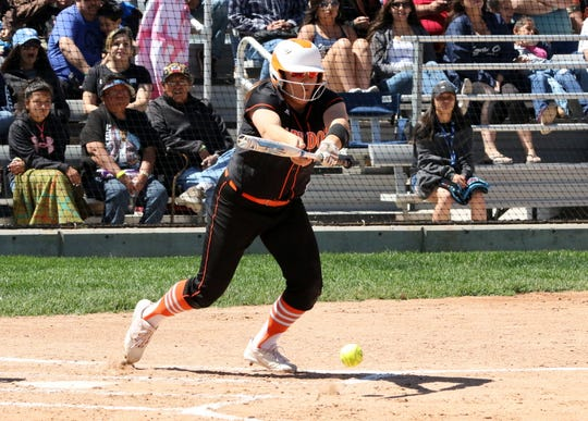 Artesia's Tanner Sanchez drops a bunt during Saturday's championship game.