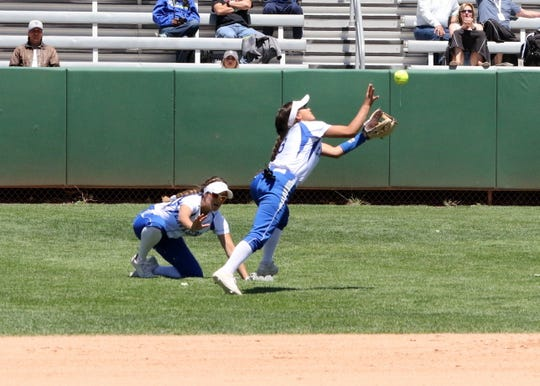 Marissa Reyes avoids teammate MJ Martinez to catch a fly ball during Saturday's championship game against Rio Rancho.