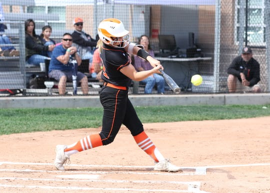 Artesia's Melody Payne connects for a solo home run during Saturday's championship game against Silver. She will be one of the six softball players representing Eddy County in the All-Star softball game in June.