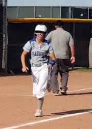 Jessica Munroe runs home after hitting a 3-run homer against Hobbs on Friday. Carlsbad won in four innings, 17-2.