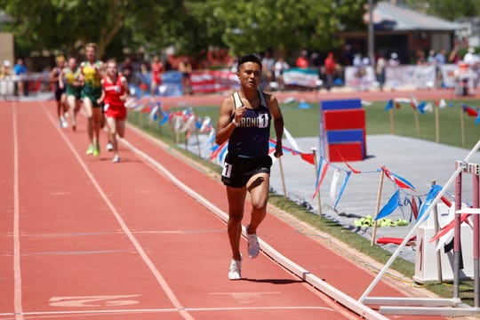 Kirtland Central's Kashon Harrison pulls far ahead of the pack entering the final lap of the 4A boys 1,600-meter run during Saturday's state track and field championships in Albuquerque. Harrison won back-to-back state titles in both the 1,600 and 3,200-meter runs.