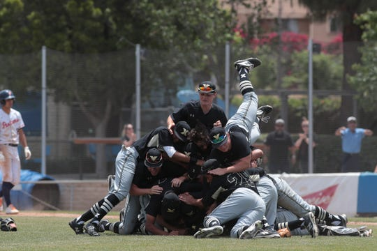 Xavier Prep baseball celebrates after defeating Poly Pasadena in the CIF-SS Division 5 championships, Riverside, Calif., May 18, 2019.