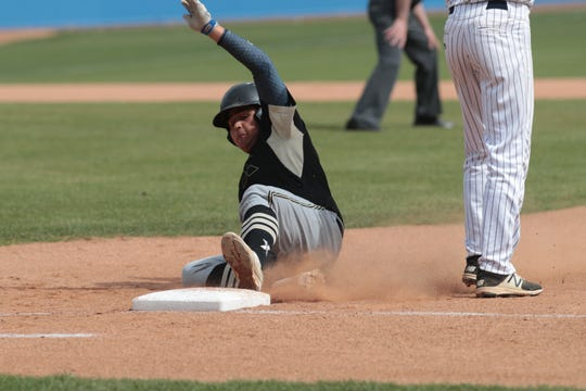 Jordan Ruiz slides to tag up at first base in Xavier Prep's game against Poly Pasadena in the CIF-SS Division 5 championships, Riverside, Calif., May 18, 2019.