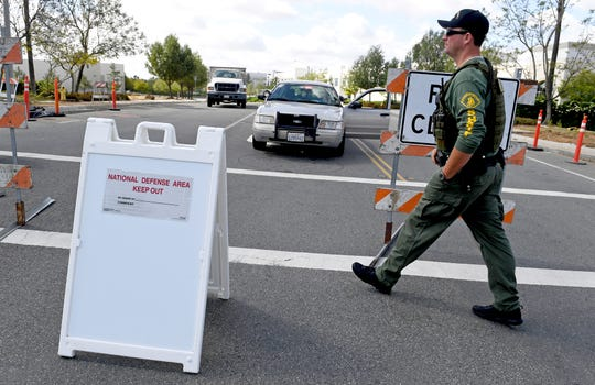 "A ""National Defense Area Keep Out"" sign is posted at Innovation Drive and Cactus Ave just west of the 215 freeway in Riverside, Calif.  Friday, May 17, 2019. A wide area including a freeway around an F-16 fighter jet crash site in Southern California remained off-limits Friday as military and civilian authorities investigated. (Jennifer Cappuccio Maher/The Orange County Register via AP)"