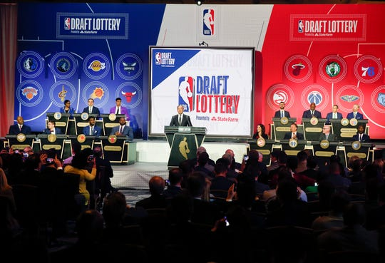 NBA Deputy Commissioner Mark Tatum gets ready to announce the order of the picks during the NBA basketball draft lottery Tuesday, May 14, 2019, in Chicago.