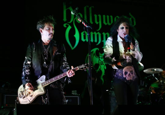 Johnny Depp and Alice Cooper of The Hollywood Vampires perform at The Pool at Talking Stick Resort on May 17, 2019 in Scottsdale, Ariz.