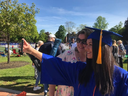 SUNY New Paltz graduate Kaitlyn Estrada of the City of Poughkeepsie takes a selfie with her mother, Donna Estrada, on Saturday.