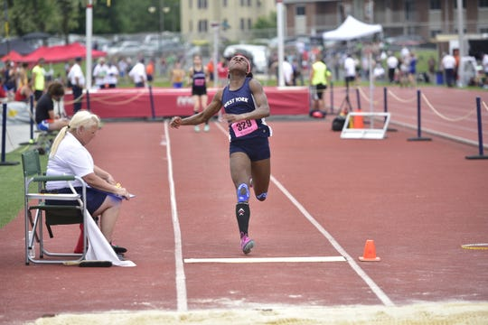 West York's Tesia Thomas earned her second gold medal of the weeknd, this time in the long jump, at the District 3 track and field championships at Shippensburg University on May 18, 2019