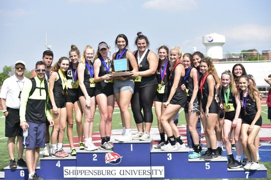 Delone Catholic's girls team poses after winning the team title at the District 3 track and field championships at Shippensburg University on May 18, 2019