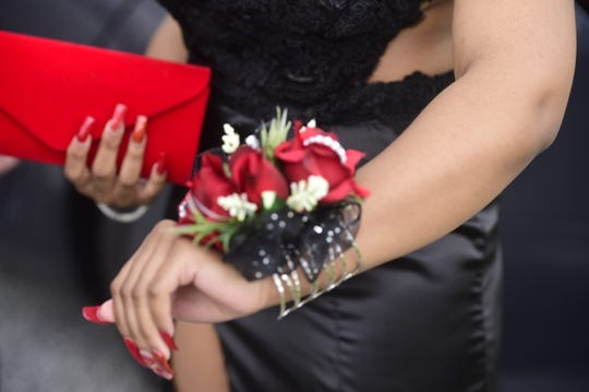 York Tech senior Aveyon Parker displays the corsage she wore to York Tech's prom Friday, May 17, 2019.