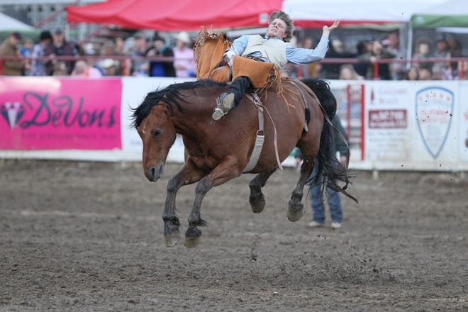 Jacob Lees of Pismo Beach competes Friday, May 17, 2019, in the bareback riding event at the 71st annual Redding Rodeo.