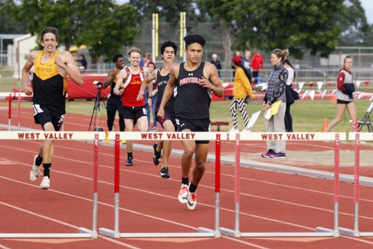 Dylan Northrup of Foothill leads in the 300m hurdles at the NSCIF track and field finals hosted by West Valley on Friday, May 17.