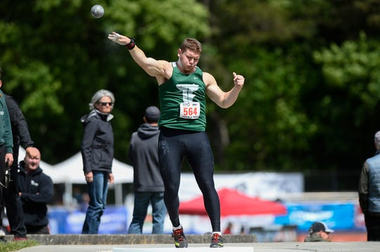 Salem Academy's Mason Strunk competes in the 3A boys shot put during the OSAA 3A/4A State Track and Field Meet at Mt. Hood Community College Friday, May 17.