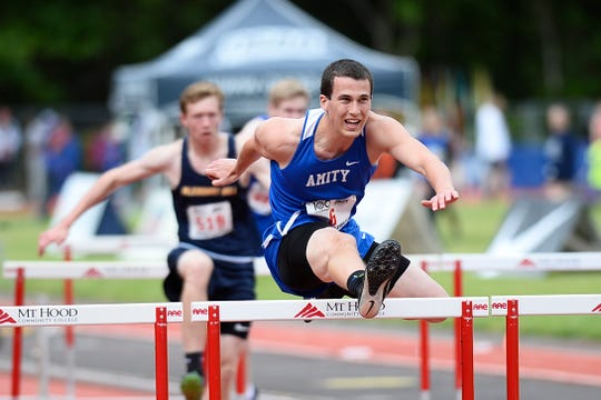 Amity's Jonathan Mather competes in a preliminary of the 3A boys 110-meter hurdles during the OSAA 3A/4A State Track and Field Meet at Mt. Hood Community College Friday, May 17.