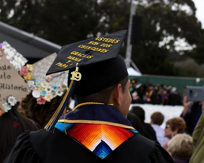 "Uziel Reyes wrote ""Ustedes son los chingones, gracias mama y papa"" on his graduation cap for the 2019 CSUMB graduation from the college of Arts, Humanities and Social Sciences. In English, that translates to: ""you guys are the greatest, thank you mom and dad."" May 18, 2019."