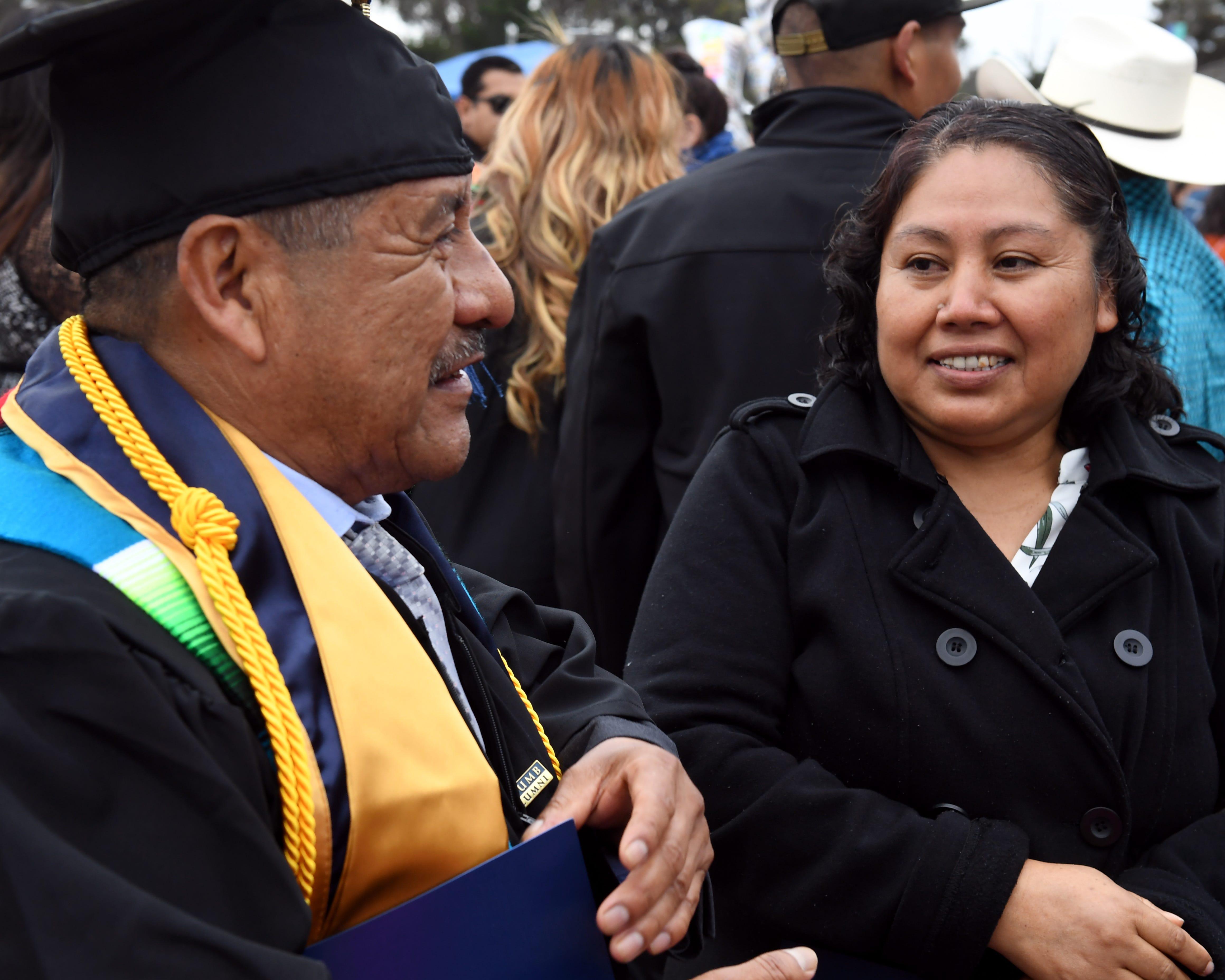 Maria Ibarra González congratulates her husband, Adolfo González, on earning his degree on May 18, 2019.
