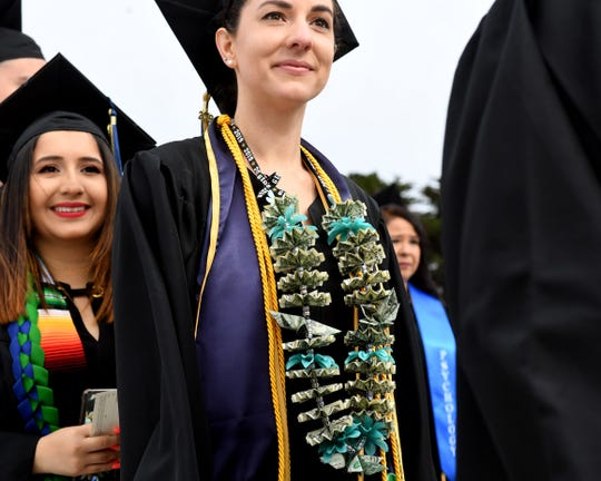 A woman wears a money lei Saturday during CSUMB graduation from the College or Arts, Humanities and Social Sciences on Saturday, May 18.