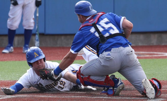 Angelo State University's Riley Peterson slides into home base in a game against Lubbock Christian at the South Central Regional at Foster Field at 1st Community Credit Union Stadium Friday, May 17, 2019. Peterson was out on the play.