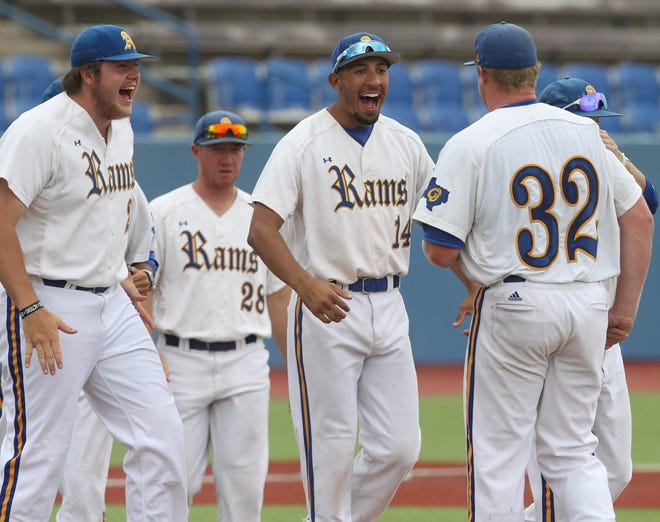 The Angelo State University baseball team celebrates beating Lubbock Christian at the South Central Regional at Foster Field at 1st Community Credit Union Stadium Friday, May 17, 2019.