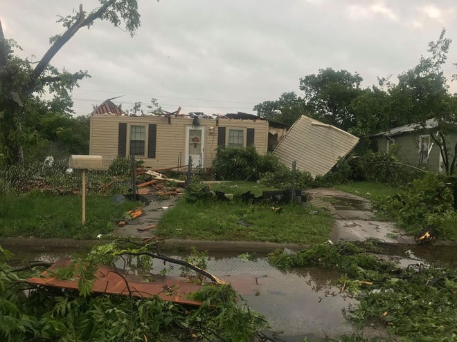 A San Angelo residence on East 22nd street appears demolished after a powerful storm system moved through the area, Saturday, May 18, 2019.