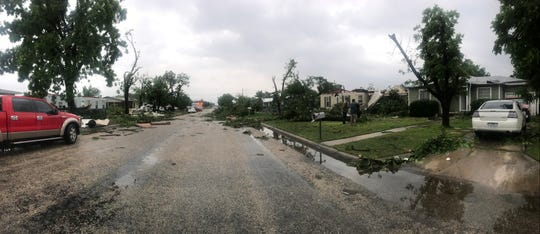 About 8 a.m. Saturday, May 18, 2019 residents of the neighborhood near Bradford Elementary were evaluating the damage done to their homes during a severe early morning storm.