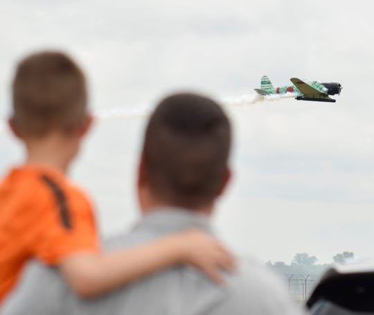 A man and a young boy watches a performance during the 2019 Barksdale Defenders of Liberty Air & Space Show on Saturday, May 18, 2019.