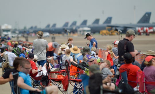 People sit in chairs and on blankets during the 2019 Barksdale Defenders of Liberty Air & Space Show on Saturday, May 18, 2019.