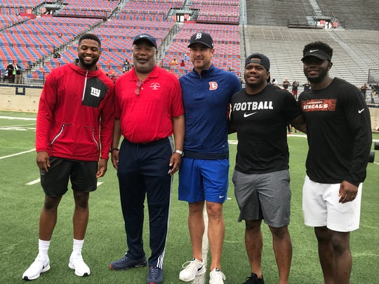 N.Y. Giants cornerback Michael Hunter, Caddo District attorney James Stewart, former LSU quarterback Josh Booty, former San Francisco cornerback Ramon Broadway and Cincinnati safety Brandon Wilson share a moment Saturday in Independence Stadium.