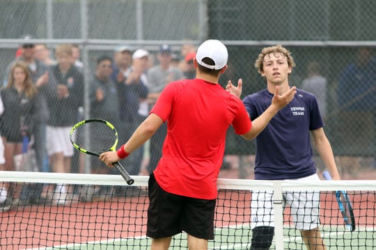 Sam Dobbs of Lincoln and Cade Damgaard of O'Gorman shake hands after the #1 Singles Championship match on Saturday in Sioux Falls.