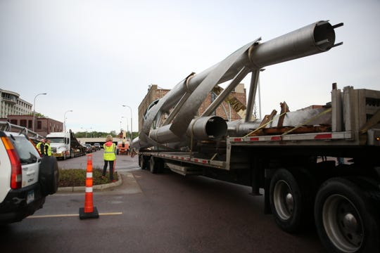 Several people gather in the Raven Industries parking lot May 18 in downtown South Dakota as pieces of the Arc of Dreams sculpture arrive in Sioux Falls. The sculpture is expected to be constructed by mid June.