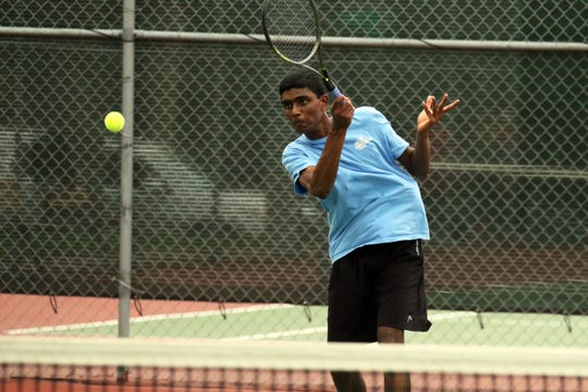 Rahul Giri of Lincoln follows his return to Dawson Segrist of Rapid City Stevens during the #3 singles match on Saturday in Sioux Falls.