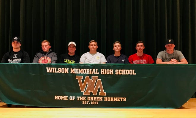 Wilson Memorial senior athletes make their college choices Friday afternoon in the school auditorium.