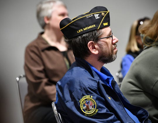 Veteran Brandon Rogers listens during a town hall meeting on the Central Minnesota Habitat for Humanity Veterans Build program Saturday, May 18, in St. Cloud.