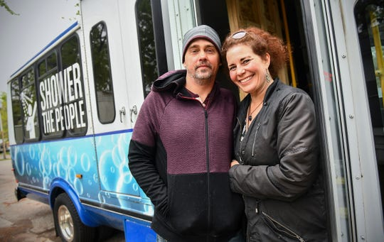 Jason Jaques and Nancy Dyson stand next to their mobile shower van they will operate as part of their nonprofit, Neighbors to Friends, during an interview Saturday, May 18, at their home in Sauk Rapids.