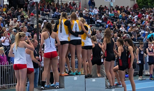Desert Hills' 4x400-meter relay girl's team takes first on the podium, after winning the 4x400 4A girl's relay.