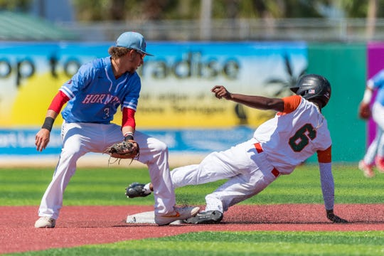 Seyjuan Lawrence slides safely into second base versus Delaware State. FAMU recorded a 9-8 win in 10 innings to eliminate the Hornets from the  MEAC Baseball Championship at Jackie Robinson Ballpark in Daytona Beach.