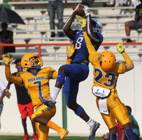 Godby receiver Avery Boyd high points a touchdown catch as the Cougars beat beat Rickards 21-14 during the Big Bend Spring Football Classic jamboree at Florida A&M's Bragg Memorial Stadium on May 18, 2019.