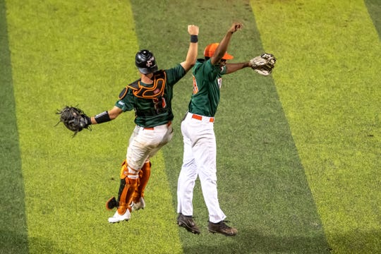 FAMU catcher Bret Maxwell (left) and closer Jeremiah McCollum leap for joy after beating North Carolina A&T to advance to the MEAC championship game.