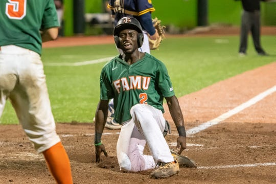 FAMU outfielder Willis McDaniel slides home for an insurance run. The Rattlers defeated N.C. A&T 6-2 Friday night at Jackie Robinson Ballpark in Daytona Beach. They advanced to the MEAC baseball title game.