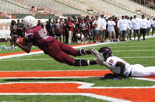 Madison County's Zechariah Jones hauls in a catch for a touchdown. The Cowboys beat Chiles 21-6 during a spring jamboree game at Florida A&M's Bragg Memorial Stadium on May 18, 2019.