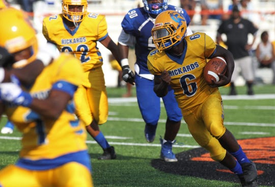 Rickards junior running back De'Andre Francis cuts outside for a 40-yard touchdown run as Godby beat Rickards 21-14 during the Big Bend Spring Football Classic jamboree at Florida A&M's Bragg Memorial Stadium on May 18, 2019.
